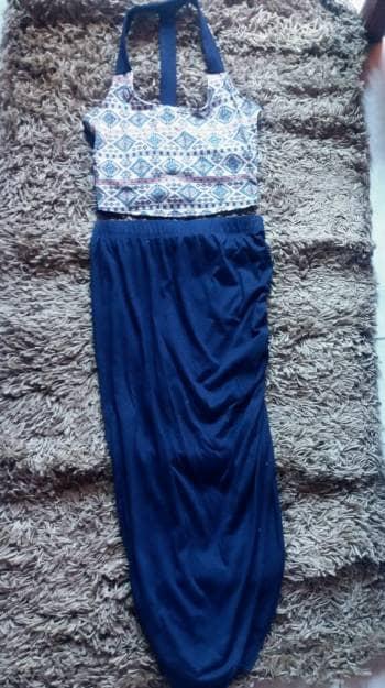 Foto Carousel Producto: Conjunto de crop top y falda larga con recojido GoTrendier