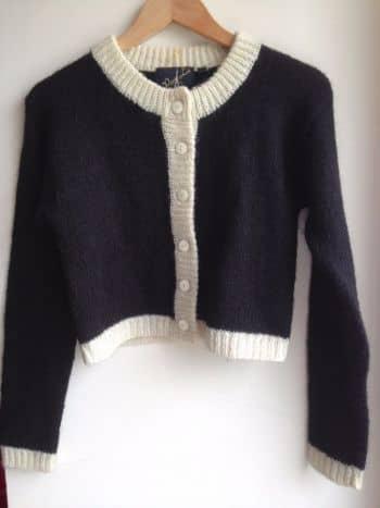 Foto Carousel Producto: Saco lana negro y blanco GoTrendier
