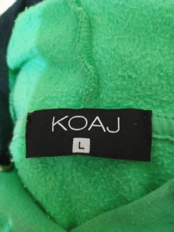 Foto Carousel Producto: Buzo overside verde de koaj GoTrendier
