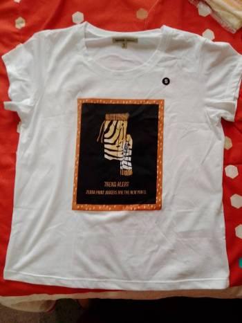 Foto Carousel Producto: Camisa blanca con estampado cebra GoTrendier