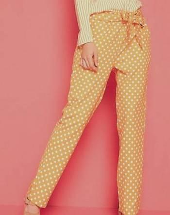 Foto Carousel Producto: Pantalón mostaza lunares blancos GoTrendier