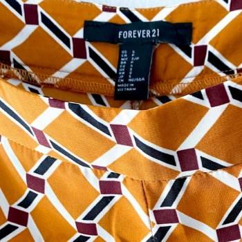 Foto Carousel Producto: Pantalón mostaza estampado GoTrendier